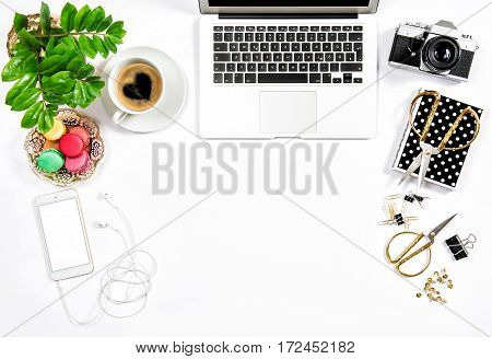 Feminine workplace still life. Coffee and macaroon cookies. Office supplies and laptop. Valentines Day. Love. Heart
