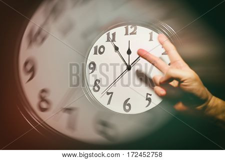 wall clock face and victory sign concept of success