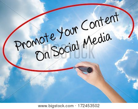 Woman Hand Writing Promote Your Content On Social Media  With Black Marker On Visual Screen