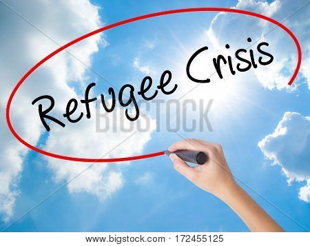 Woman Hand Writing Refugee Crisis With Black Marker On Visual Screen
