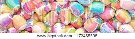 Many watercolor easter eggs as panorama background (3D Rendering)