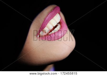 beautiful teeth on a dark background. mouth woman patient at a reception at the dentist