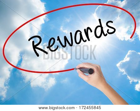Woman Hand Writing Rewards With Black Marker On Visual Screen