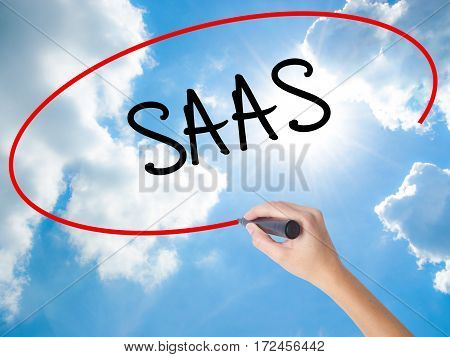 Woman Hand Writing Saas With Black Marker On Visual Screen