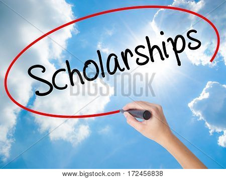 Woman Hand Writing Scholarships With Black Marker On Visual Screen