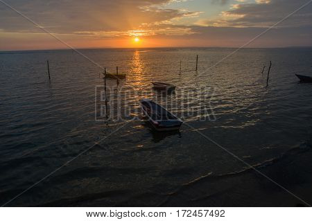Aerial view sunrise with fishing boats above Tanjung Aru village in Labuan island,Malaysia.Tanjung Aru Labuan is a good destination to discover the fishing village traditions