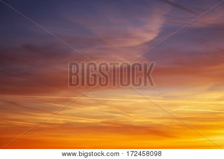 Fiery orange colorful sunset sky as background