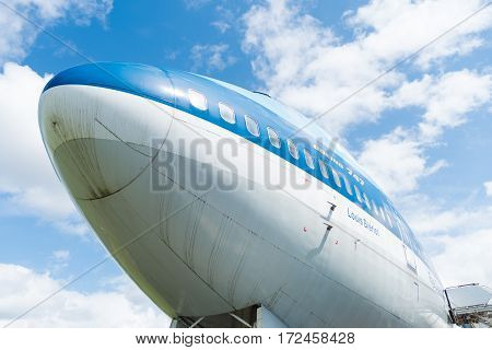 LELYSTAD NETHERLANDS - MAY 15 2016: Low angle view of a blue KLM 747 jumbo jet at the aviodrome aerospace museum at lelystad airport