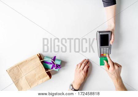 Present purchase in shop with payment by credit card on white table background top view mock-up