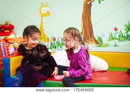 Cute Girls Talking And Playing In Kindergarten For Kids With Special Needs