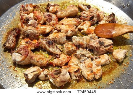 Paella from Spain recipe fry chicken and rabbit second step