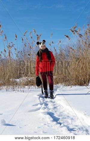 Girl On A Background Of A Winter Landscape.