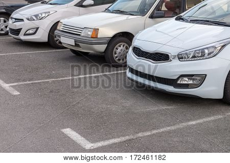 view of cars on a street parking
