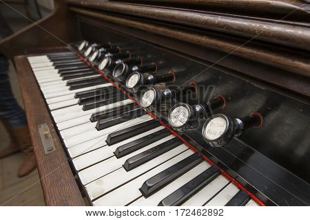 old keyboard musical instrument with keys close-up