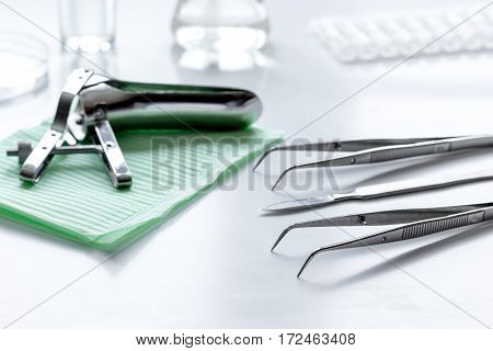 instruments of gynecologist on white background close up