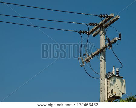 electric pole standing on the field technology industrial.