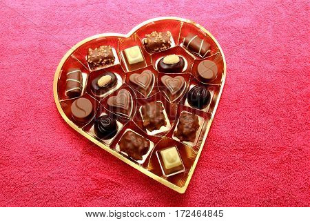 Luxurious chocolates in a heart shape  golden box