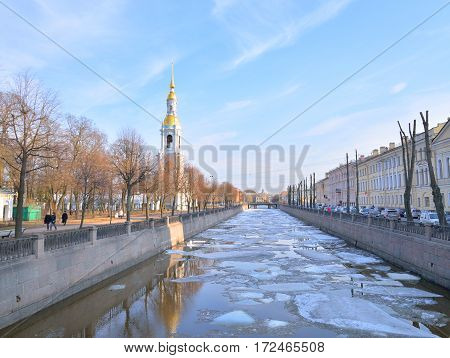 Bell tower of Naval Cathedral of St. Nicholas and Kryukov Canal in St.Petersburg at sunny day Russia.