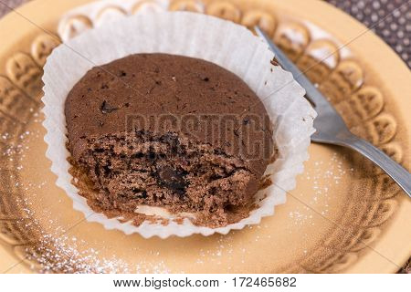 Chocolate Cupcake Muffin With Powdered Sugar On The Plate