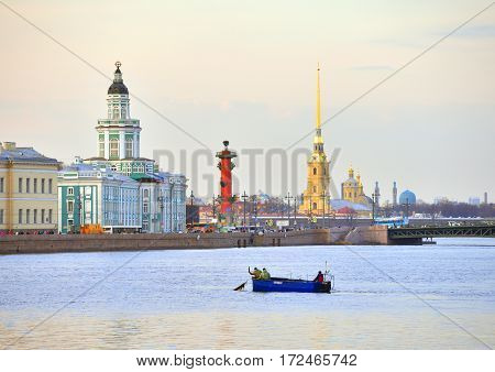 University Embankment and the Neva River at evening in St.Petersburg Russia. poster