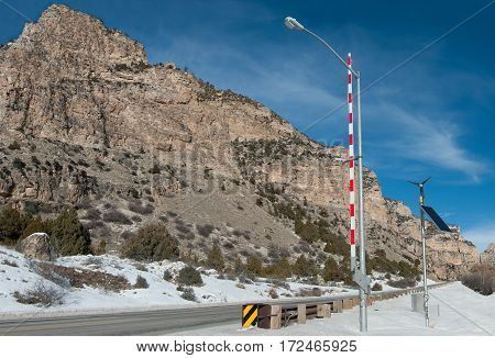 Mountain Road Access Gate:  A tall gate regulates winter travel in the Bighorn Mountains of Wyoming.