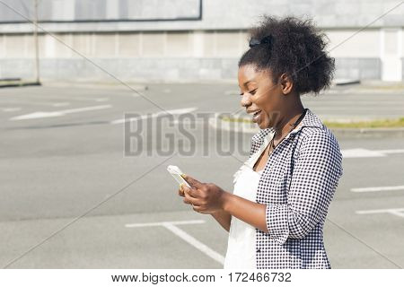 African Woman Texting On Her Smart Phone.