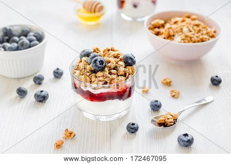 Healthy morning with granola and berries breakfast on white kitchen table background