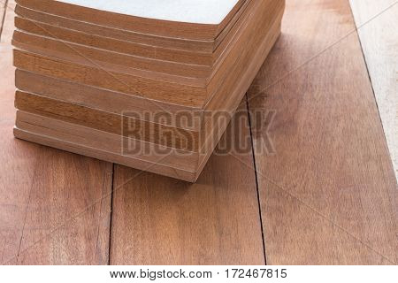 stack of old book on wooden table