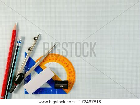 Mathematical Instruments Over The Corner Of A Math Graph Paper With Copy Space For Text. Math Graphi