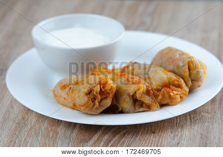 stuffed cabbage - a traditional Ukrainian cuisine braised cabbage leaves stuffed with minced meat and rice with sour cream