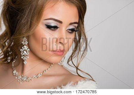 Portrait of a young womanl with fashion hairstyle and make-up