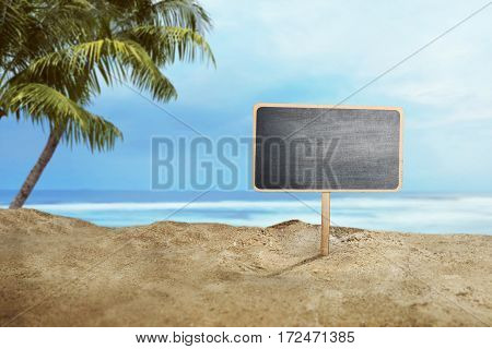 Blank Wooden Sign On Sand