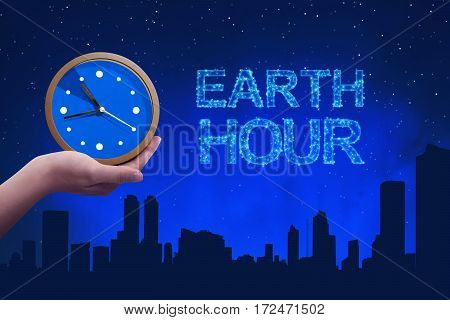 People Hand Holding A Clock With Earth Hour Greeting