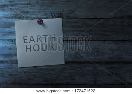 Hanging Note Paper With Earth Hour Message On Wooden Wall