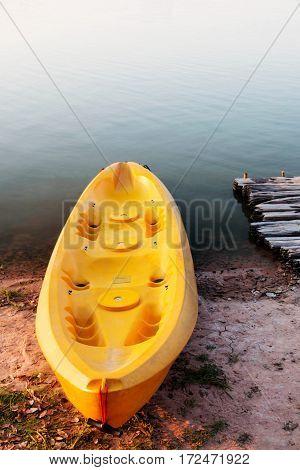 old kayak boat in lake for recreation