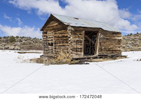 Old Weathered Ghost Town Buildings In The Desert During Winter With Snow.  Ione, Nevada