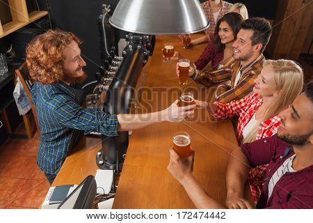 Young People Group In Bar, Barman Friends Sitting At Wooden Counter Pub, Drink Beer Communication Party Celebration