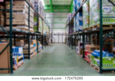 keep of warehouse. Rows of shelves with boxes (Blur Picture)