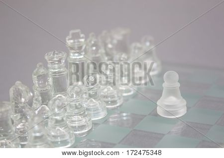 Glass Chess On A Gray Background.