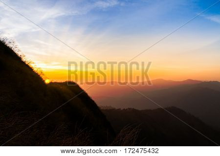 Sunset in the silhouette mountains beautiful landscape with sunrays