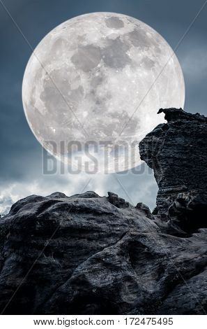 Super Moon Or Big Moon. Sky Background With Large Full Moon Behind Boulder.