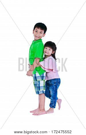 Asian sister standing and hugging his brother smiling happily isolated on white background. Concept about loving and bonding of sibling. Happy family spending time together. Studio shot.