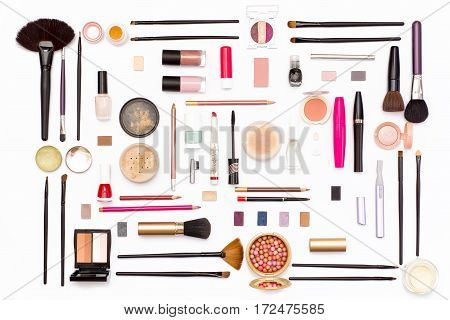 Makeup Cosmetics, Brushes And Accessories On White Background. Top View.