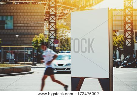 Empty mock up banner for your advertising blank billboard with copy space area for your text message or promotional content public information board in front of running man and police car