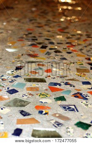 Mosaic tile spread across the pavement sidewalk
