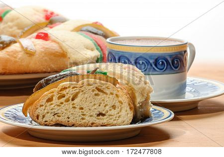 Chocolate cup with Epiphany cake Kings cake Rosca de reyes or Roscon de reyes