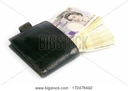leather wallet with bills British pounds as part of the UK economy and the trading system