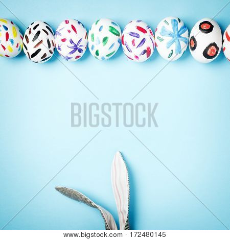 Easter. Easter bunny on a blue background. Rabbit. Easter ideas. Easter eggs. Space for text. Happy easter.