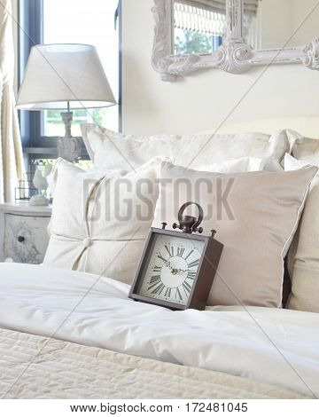 Luxury Bedroom Interior With Classic Style Alarm Clock On Bed
