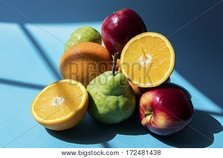 Heap of fruits on blue table